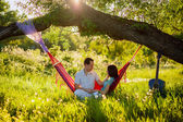 Couple relaxing in a hammock — Stock Photo