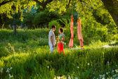 Couple outdoors near the swing — Stock Photo