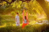 Couple  riding on a swing — Stock Photo