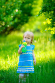 Girl drinks water on the nature — Stock Photo