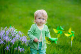 Child playing with toys in the park — Stock Photo