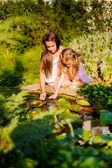 Girls playing near a pond — Stock Photo
