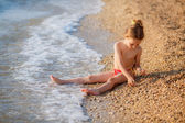 Little girl resting on the beach — Stock Photo