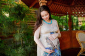 Pregnant woman near the arbor — Stock Photo