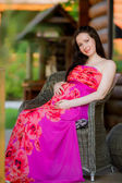 Pregnant girl sitting on the chair — Foto de Stock
