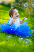 Happy little girl in the park — Stock Photo