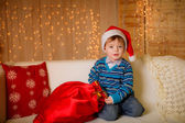 Boy in a Christmas hat — Stock Photo