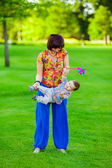 Mother and her baby playing on the grass. — Stock Photo