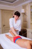 Doctor massaging little boy — Stockfoto
