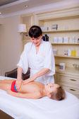 Doctor massaging little boy — Stok fotoğraf