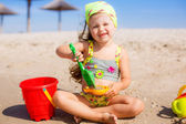 Little girl  building sand castle — Stock Photo