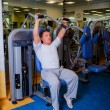 Fit man exercising at the gym — Stock Photo #50136541