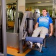 Fit man exercising at the gym — Stock Photo #50149767