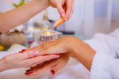 Woman has hand spa with shell — Stock Photo