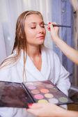 Makeup artist doing makeup for beautiful girl — Stock Photo