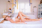 Girl  in lingerie lying in beauty salon — Stock Photo
