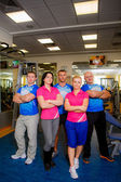Personal trainers in gym — Stock Photo