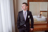 Groom in the room — Stock Photo