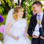 Happy newlyweds drinking champagne — Stock Photo #50383585