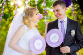 Happy newlyweds in nature — Stock Photo