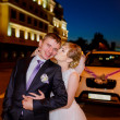Newlyweds walk on the evening city — Stock Photo #50391197