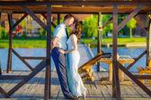 Happy newlyweds on the lake — Stock Photo