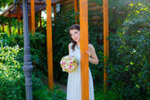 Happy bride with a bouquet, outdoor — Stock Photo