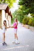 Girl riding rollerblading on a summer day — Stock Photo