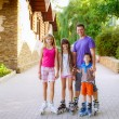 Family riding rollerblading — Stock Photo #50622625