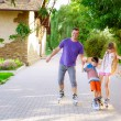 Family riding rollerblading on a summer day — Stock Photo #50622801