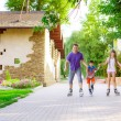 Family riding rollerblading on a summer day — Stock Photo #50622853