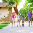 Family riding rollerblading — Stock Photo #50623169