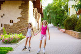 Girls  riding rollerblading on a summer day — Stock Photo