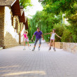 Family riding rollerblading on a summer day — Stock Photo #50641195