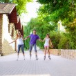 Family riding rollerblading on a summer day — Stock Photo #50641255