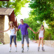 Family riding rollerblading on a summer day — Stock Photo #50641329