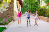 Mother and daughters riding rollerblading — Stock Photo