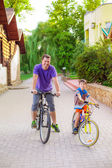 Dad and son  ride on bicycles — Stock Photo