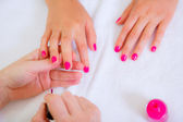 Girl doing manicure in beauty salon — Stock Photo