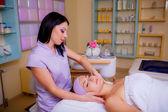 Woman  receives head massage — Стоковое фото