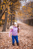 Beautiful girl playing with leaves — Stock Photo