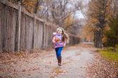 Girl running in the autumn park — Stock Photo