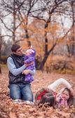 Family in the park autumn. — Stock Photo