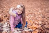 Beautiful girl in the autumn garden. — Stock Photo
