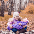 Two sisters in the autumn park — Stock Photo #50784717