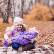 Two sisters in the autumn park — Stock Photo #50784735