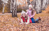 Mom walks in autumn park with her daughter — Stock Photo