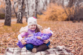 Two sisters in the autumn park — Stock Photo