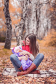 Mother with daughter autumn park — Stock Photo