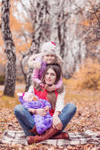 Mother with her daughters autumn park — Stock Photo